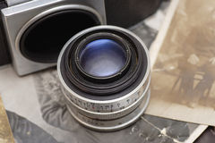 Vintage camera and lens Royalty Free Stock Photo