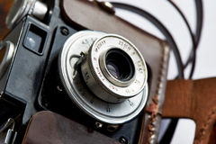 Vintage camera lens in leather case Royalty Free Stock Photos