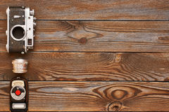 Vintage camera and lens on wooden background Stock Photography