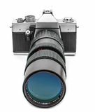 Vintage camera with long lens Royalty Free Stock Image