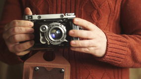Vintage camera. The man opens a vintage camera. Vintage photo camera in the hands Lifestyle stock footage