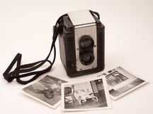 Vintage camera memories. Vintage camera with phots from the past Royalty Free Stock Photography