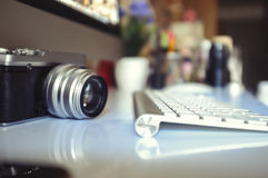 Vintage camera and modern desktop computer. Elevated view of a photographer / graphic designer desk Royalty Free Stock Photo