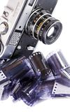 Vintage camera and negative film strips. Royalty Free Stock Photography