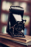 Vintage camera in office Royalty Free Stock Images