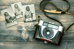 Vintage camera and old baby photos. Retro style toned picture royalty free stock photos