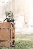 Vintage camera on old baggage bag on grass Royalty Free Stock Photography