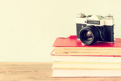 Vintage camera on old books. vintage effect. Pic Royalty Free Stock Photo