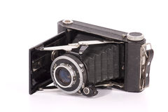Vintage Camera. An old fashioned bellows camera isolated on white background Royalty Free Stock Photo