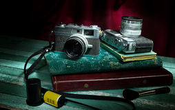 Vintage camera with old photo album Stock Images