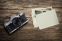 Vintage camera with old photo Royalty Free Stock Images