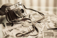 Vintage camera with old pictures Stock Photos