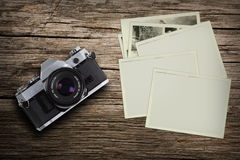 Vintage camera with old pictures Stock Photography