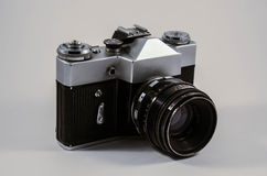 Vintage camera. Old school vintage photocamera from 1960s photographed in a lightbox with all the logos removed royalty free stock images