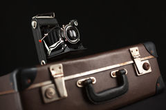 Vintage camera and old suitcase Stock Photos