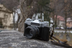 Vintage camera. Outside on a rock Royalty Free Stock Photo