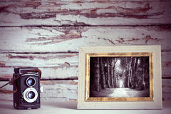 Vintage camera and photo frame Royalty Free Stock Image