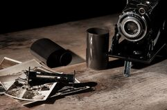 Free Vintage Camera, Photographic Film And Old Photos On A Wooden Table Stock Photos - 188733073