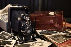 Vintage camera and photographs Royalty Free Stock Photo