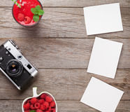 Vintage camera, photos and raspberry smoothie Stock Photos