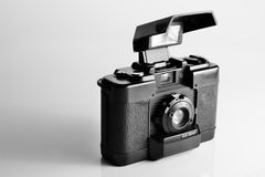 Vintage camera with pop-up flash. Vintage film camera cover open with build-in pop-up flash in black and white Royalty Free Stock Photography
