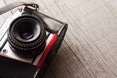 Vintage camera from 1970s on a wooden background with copy space Stock Photos