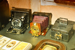 Vintage camera set. Old vintage camera set with photos and albums stock images