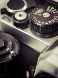 Vintage camera shutter speed knob. Macro photo of the shutter knob and shutter release of an old 35mm film camera. Filtered to look vintage Royalty Free Stock Photography