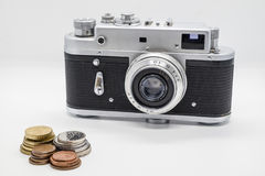 Vintage camera some money and a coins. Old black and silver camera some money and a coins Stock Photo