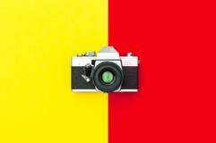 Vintage camera stylish yellow red background minimal Royalty Free Stock Image