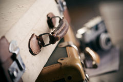 Vintage camera and suitcase. Vintage camera and old worn-out suitcase, travel concept Stock Images