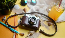 Vintage Camera Between Summer Beach Accessories on Yellow Backgr. Ound Stock Photos