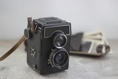 Vintage camera on the table royalty free stock photo