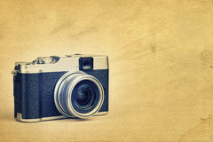 Vintage camera on a textured background Royalty Free Stock Images