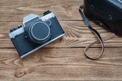 Vintage camera on textured boards. royalty free stock image