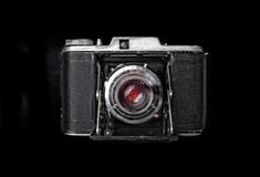 Vintage camera from top view isolated. Picture from old camera isolated on black Stock Image