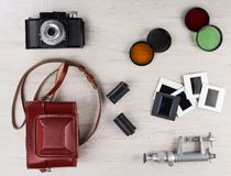Vintage camera with various accessories. Stock Photography