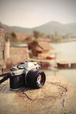 Vintage camera with view of lake and mountain Stock Image