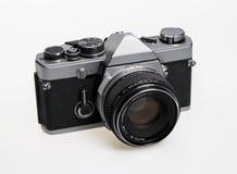 Vintage camera on a white background. Vintage 35mm film camera on a white background stock photos