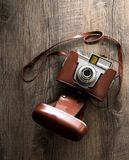 Vintage camera on wood background Stock Photography