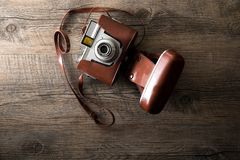 Vintage camera on wood background Royalty Free Stock Photo