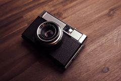 Vintage camera. On a wood surface Royalty Free Stock Photo