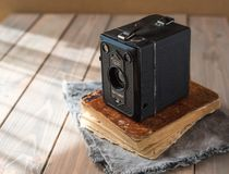 Vintage camera on wooden background and book royalty free stock photo