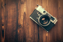 Vintage camera on wooden background. Vintage camera on brown wooden background Royalty Free Stock Photography