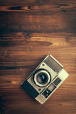 Vintage camera on wooden background Stock Photo