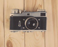 Vintage camera on wooden background Stock Images