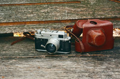 Vintage camera on wooden bench in autumn park Royalty Free Stock Photo