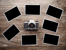 Vintage camera on wooden with photo frames Royalty Free Stock Photos