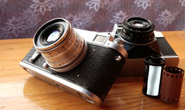 Vintage camera on wooden table Stock Photography