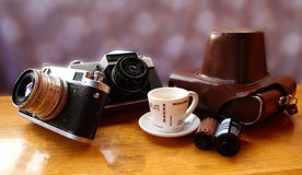Vintage camera on wooden table Royalty Free Stock Photo